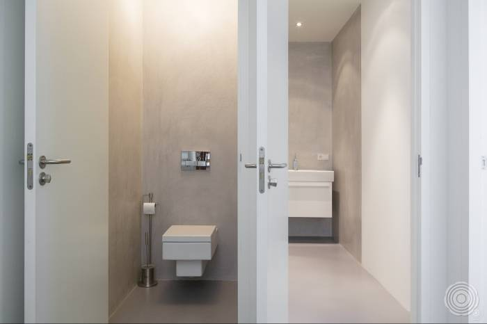 a relaxed shower room showering on a clean floor excess wate